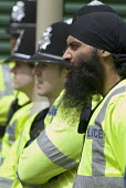 Sikh police officer during EDL protest in Dudley - Timm Sonnenschein - 17-07-2010