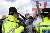 Protestor making a Sieg Heil fascist salute, EDL protesters approach police in an attempt to break through police lines during, Dudley - Timm Sonnenschein - ,2010,2010s,activist,activists,adult,adults,baton,batons,bigotry,break,CAMPAIGN,campaigner,campaigners,CAMPAIGNING,CAMPAIGNS,cities,city,CLJ,confront,confrontation,confronted,confronting,DEMONSTRATING