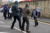 EDL members fighting with local asian men after they broke out of their static protest site, Bradford - Timm Sonnenschein - 28-08-2010