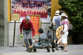 A severely disabled man begging outside the Jade Buddha Temple, Shanghai - Timm Sonnenschein - 12-08-2010