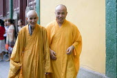 A younger and an elderly monk return from a ceremony at the �Buddhist �Lingyin temple site, �Hangzhou, China - Timm Sonnenschein - &, Chinese,2010,2010s,age,ageing population,belief,buddha,Buddhism,buddhist,buddhists,ceremonies,ceremony,China,conviction,elderly,EMOTION,EMOTIONAL,EMOTIONS,faith,GOD,happiness,happy,LIFE,monk,monks,