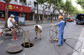 Workers install new wiring underground in the Hongkou district, Shanghai - Timm Sonnenschein - 05-08-2010