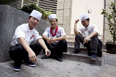 Chefs taking a break at the back of a restaurant, Shanghai - Timm Sonnenschein - 11-08-2010