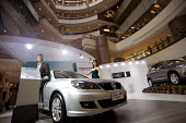 Elaborate Volkswagen sales presentation with models at Zheng Da Plaza, Pudong, Shanghai. Volkswagen is the biggest foreign carmaker in China, sold 1.4 million cars in 2009 and plans to increase to 2 m... - Timm Sonnenschein - Chinese,2010,2010s,AFFLUENCE,AFFLUENT,AUTO,auto industry,AUTOMOBILE,AUTOMOBILES,Automotive,Bourgeoisie,capitalism,capitalist,car,Car Industry,carindustry,cars,China,cities,city,consumer,consumerism,co