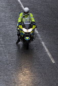 Police officer on a motorbike - Timm Sonnenschein - 2010,2010s,adult,adults,bike,bikes,BMW R1200RT,cities,city,CLIMATE,CLJ,conditions,force,highway,MATURE,motorbike,MOTORBIKES,motorcycle,motorcycles,motorcycling,motorcyclist,motorcyclists,officer,OFFIC