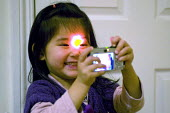 A three year old girl taking self portraits with a compact digital camera - Timm Sonnenschein - 2010,2010s,Amateur Photographer,BAME,BAMEs,BME,bmes,camera,cameras,child,CHILDHOOD,children,chinese,digital,diversity,EMOTION,EMOTIONAL,EMOTIONS,ethnic,ethnicity,female,females,funny,girl,girls,having