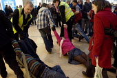 UK Uncut activists are removed from the Birmingham Bullring by security guards as they attempt a sitin at Topshop, owned by Sir Philip Green who is an alleged tax evader. - Timm Sonnenschein - 18-12-2010