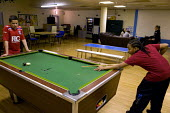 Young people playing pool the �Northfield YMCA youth centre. Local youth services may be cut. - Timm Sonnenschein - &,2010s,2011,adolescence,adolescent,adolescents,ball,balls,BAME,BAMEs,belief,black,BME,bmes,boy,boys,charitable,charity,child,CHILDHOOD,children,cities,city,club,clubs,communities,community,conviction