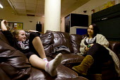A youth worker talking with young girl, �Northfield YMCA youth centre. Local youth services may be cut. - Timm Sonnenschein - &,2010s,2011,adolescence,adolescent,adolescents,advice,ADVISE,ADVISER,advisers,advising,advisor,advisors,BAME,BAMEs,belief,Black,BME,bmes,CARE,carer,carers,charitable,charity,child,childcare,CHILDHOOD