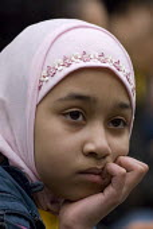 A muslim girl, Birmingham - Timm Sonnenschein - 2010s,2011,activist,activists,BAME,BAMEs,Birmingham,Black,BME,bmes,bored,boredom,boring,CAMPAIGN,campaigner,campaigners,CAMPAIGNING,CAMPAIGNS,child,CHILDHOOD,children,cities,city,DEMONSTRATING,demonst