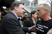 Ed Balls is confronted by �Bill Maloney of Pie & Mash Films on tackling child abuse at the TUC March for the alternative. Jobs, Growth and Justice. London. - Timm Sonnenschein - 2010s,2011,abuse,activist,activists,against,alternative.,and,anger,angry,anti,argue,arguing,argument,Austerity Cuts,Balls,CAMPAIGN,campaigner,campaigners,CAMPAIGNING,CAMPAIGNS,communicating,communicat