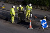 Amey subcontractors repairing potholes in the road surface due to frost damage for Birmingham City Council. - Timm Sonnenschein - 03-04-2011