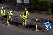 Amey subcontractors repairing potholes in the road surface due to frost damage for Birmingham City Council. - Timm Sonnenschein - 2010s,2011,Asphalt,Birmingham,boss,bosses,cities,city,communicating,communication,contractor,contractors,Council Services,Council Services,EARNINGS,EBF,Economic,Economy,employee,employees,Employment,E
