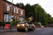 Amey subcontractors carrying out carriageway resurfacing of a residential road �for Birmingham City Council. - Timm Sonnenschein - 28-06-2011
