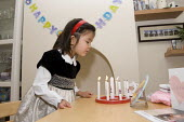 A girl blowing out candles on her fourth birthday. - Timm Sonnenschein - 19-06-2011
