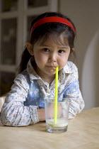 A girl drinking a glass of soya milk. - Timm Sonnenschein - 04-05-2011