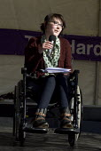 Kathryn Cartwright, who has leukaemia, speaks during the The Hardest Hit disabled people protest against government cuts, Victoria Square, Birmingham - Timm Sonnenschein - 2010s,2011,activist,activists,against,Birmingham,CAMPAIGN,campaigner,campaigners,CAMPAIGNING,CAMPAIGNS,cuts,DEMONSTRATING,demonstration,DEMONSTRATIONS,disabilities,disability,disability living allowan