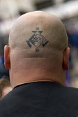 Nazi skinhead Wayne Baldwin with a Blood and Honour SS skull tattoo on his head during the EDL protest in Birmingham - Timm Sonnenschein - 29-10-2011
