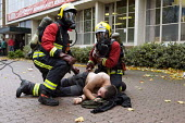 Firefighters and a volunteer during Birmingham Shield exercise simulating a chemical, biological, radiological or nuclear (CBRN) incident - Timm Sonnenschein - 30-10-2011