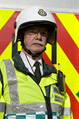 Bronze Commander of West Midlands Ambulance Service staff during Birmingham Shield exercise simulating chemical, biological, radiological or nuclear (CBRN) incident - Timm Sonnenschein - 2010s,2011,adult,adults,ambulance,AMBULANCES,and,apparel,atomic,attack,attacking,attacks,biohazard,biological,BIOLOGY,Birmingham,Chemical,CHEMICALS,cities,city,civil,clothing,commander,commanders,defe