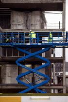 A worker on a hydraulic scissor lift. BAM contractors working at the Aston University development in Birmingham. - Timm Sonnenschein - 18-01-2012