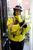 A PCSO making an inquiry to try and locate witnesses regarding a local burglary, Birmingham - Timm Sonnenschein - 2010s,2012,adult,adults,asian,asians,BAME,BAMEs,beat,Birmingham,Black,BME,bmes,burglar,burglars,Burglary,cities,city,CLJ,community policing,crime,diversity,ethnic,ethnicity,evidence,FEMALE,force,inves