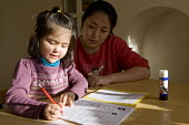 A girl practicing phonics for homework with the help of her mother, Birmingham. - Timm Sonnenschein - 2010s,2012,adult,adults,asian,asians,BAME,BAMEs,BME,bmes,book,books,child,CHILDHOOD,children,chinese,cities,city,communicating,communication,daughter,DAUGHTERS,Diaspora,diversity,edu,educate,educating