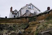 Properties on the edge of the cliff - coastal erosion, Happisburgh, Norfolk, East Anglia - Timm Sonnenschein - 14-02-2012
