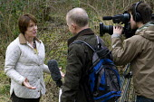 Caroline Spelman, Sec of State, DEFRA speaking to BBC reporters at Moorcroft Wood in Wednesbury as a government grant is given to Nature Improvement Areas in Birmingham and the Black Country - Timm Sonnenschein - 27-02-2012