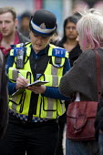 A female �British Transport Police �PCSO questioning a witness about an incident on New Street, Birmingham - Timm Sonnenschein - 2010s,2012,adult,adults,Birmingham,British Transport Police,cities,city,CLJ,communicating,communication,conversation,conversations,crime,dialogue,discourse,discuss,discusses,discussing,discussion,FEMA