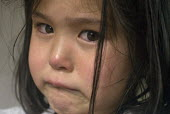 A distressed and tearful four year old girl at home. - Timm Sonnenschein - 2010s,2012,abuse,asian,asians,BAME,BAMEs,BME,bmes,CARE,carer,carers,child,Child Care,childcare,CHILDHOOD,CHILDMINDING,children,chinese,cities,city,cruel,cruelty,cry,crying,Diaspora,diversity,early yea