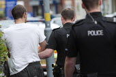 West Midlands �Police officers arresting a suspect of a drug related crime, Kings Heath, Birmingham - Timm Sonnenschein - ,2010s,2012,adult,adults,arrest,arrested,arresting,Birmingham,cities,city,CLJ,crime,custody,drug,drugs,enforcement,force,handcuff,handcuffs,MATURE,narcotic,narcotics,offence,offense,Officer,officers,p