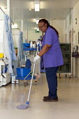 An NHS housekeeper mopping the floor, Moseley Hall Hospital, Birmingham - Timm Sonnenschein - 25-07-2012