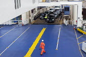 P&O workers directing cars boarding the Spirit of Britain cross-channel ferry before its departure from Dover to Calais - Timm Sonnenschein - 2010s,2012,AUTO,AUTOMOBILE,AUTOMOBILES,AUTOMOTIVE,boarding,boat,boats,capitalism,capitalist,car,cargo,cars,crew,crewman,crewmen,crewmenmaritime,cross,Cross Channel Ferry,crosses,crossing,directing,div