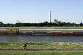 Lindos barge. River Rhine photographed from Dusseldorf Oberkassel showing the gas and steam turbine power station Lausward. Photographed from the river banks where Andreas Gursky took his Rhein II pho... - Timm Sonnenschein - 19-08-2012