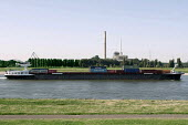 Alcotrans Container line barge Factorfour. River Rhine photographed from Dusseldorf Oberkassel showing the gas and steam turbine power station Lausward. Photographed from the river banks where Andreas... - Timm Sonnenschein - 19-08-2012