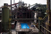 People enjoy swimming in the Werkschwimmbad at the former coking plant, Zeche Zollverein (1957 to 1961) UNESCO world heritage site, Essen, Germany - Timm Sonnenschein - 13-08-2012