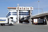 Lorries boarding a ferry from Calais to Dover, France - Timm Sonnenschein - 2010s,2012,berth,berthed,boarding,boat,boats,capitalism,capitalist,cargo,container,containers,Cross Channel Ferry,dock,docked,docks,dockside,driver,drivers,driving,EBF,Economic,Economy,employee,employ