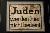 Juden werden hier nicht bedient, Jews are not served here, historic sign from Nazi Germany, Jewish Museum, Berlin, Germany - Timm Sonnenschein - 2010s,2012,ACE,against,anti,anti-Semitism,bigotry,cities,city,COMMEMORATE,COMMEMORATING,commemoration,COMMEMORATIONS,commemorative,communicating,communication,culture,discrimination,equal,equality,eu,