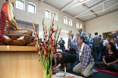 Western Buddhists chant and male offerings to the Buddha shrine during the inauguration of the Berlin Triratna Buddhist Centre, Kreuzberg, Germany - Timm Sonnenschein - 01-09-2012