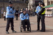 A disabled Police liaison officer in a wheelchair speaking with colleagues, TUC March for a Future that Works during the Conservative Party conference, Birmingham - Timm Sonnenschein - 2010s,2012,activist,activists,adult,adults,against,anti,Austerity Cuts,Birmingham,bound,CAMPAIGN,campaigner,campaigners,CAMPAIGNING,CAMPAIGNS,cities,city,CLJ,conference,conferences,DEMONSTRATING,demon