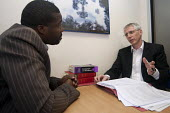 Specialist immigration solicitor Sean Mcloughlin of TRP Solicitors, Birmingham advising an African client on his case under the legal aid scheme. - Timm Sonnenschein - 08-10-2012