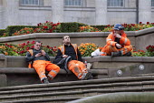 Contractors on their lunch break, Victoria Square, Birmingham - Timm Sonnenschein - 2010s,2012,Birmingham,break,break time,builder,builders,Building Worker,CELLULAR,CIGARETTE,cigarettes,cities,city,communicating,communication,Construction Workers,contractor,contractors,conversation,c