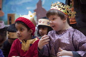 A king. Reception class performing a Nativity play, Kings Heath Primary School, Birmingham - Timm Sonnenschein - 15-12-2012