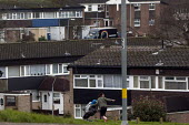 A young mother playing with her child on a council estate, Maypole, Birmingham. - Timm Sonnenschein - 06-02-2013