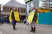 A couple wearing sandwich boards advertising the sale of their house and an option to rent now and then buy later. Selling direct to the public and avoiding estate agents fees, Kings Heath high street... - Timm Sonnenschein - 12-01-2013