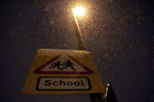 Birmingham School road sign covered in snow as schools are closed and traffic is interrupted by continuous snowfall and low tempatures below zero. - Timm Sonnenschein - 20-01-2013
