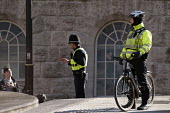 Police officers talking to a youth, Birmingham - Timm Sonnenschein - 2010s,2013,adolescence,adolescent,adolescents,adult,adults,BAME,BAMEs,beat,bicycle,bicycles,BICYCLING,Bicyclist,Bicyclists,BIKE,BIKES,Birmingham,black,BME,bmes,cities,city,CLJ,communicating,communicat