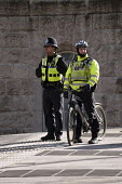 Police officers on foot and on a bicycle, Birmingham - Timm Sonnenschein - 02-02-2013