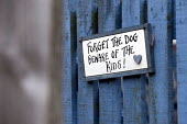 Forget the dog beware of the kids sign at a garden gate on a council estate, Maypole, Birmingham - Timm Sonnenschein - 07-02-2013